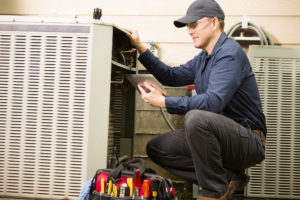 Repairmen working on a air conditioner