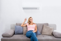 Girl starting the AC by remote